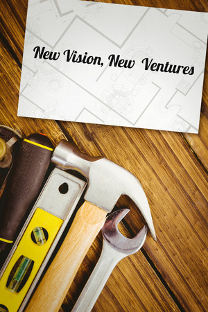 ventures: The word new vision, new  ventures and digital tablet displaying blueprint against white card Stock Photo