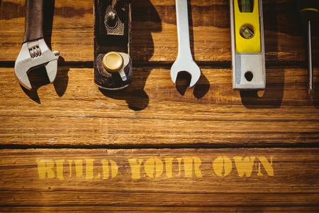 your: The word build your own against tools on desk