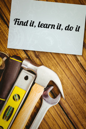 do it: The word find it, learn it, do it and architecture themed background against white card