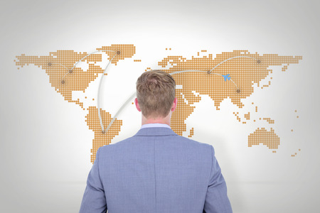 turned: A back turned businessman on a background against world map with lines