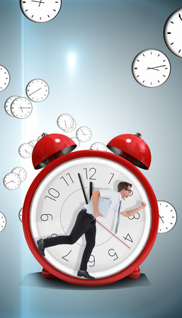 late 20s: Geeky businessman running late against digitally generated floating clock pattern