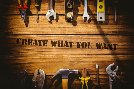 what: The word create what you want against desk with tools
