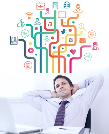 relaxed: Apps against relaxed businessman with hands behind head in office Stock Photo