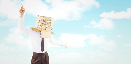 arms out: Anonymous businessman with arms out against blue sky Stock Photo