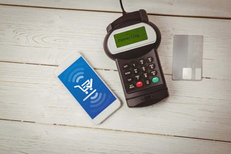 eftpos: Payment screen against paying with smartphone Stock Photo