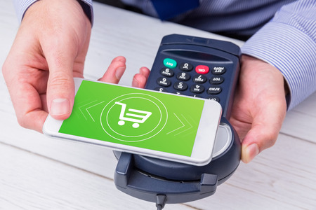 pin entry: Payment screen against man using smartphone to express pay Stock Photo
