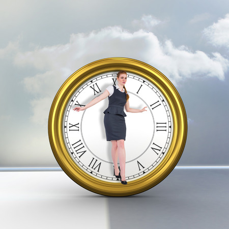 balancing act: Businesswoman doing a balancing act against clouds in a room