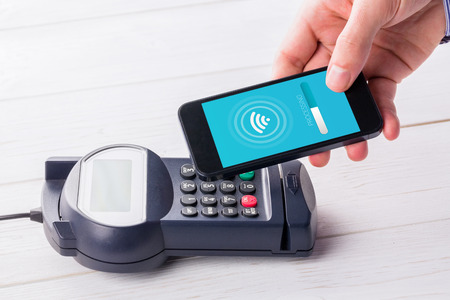 eftpos: Loading screen against man using smartphone to express pay Stock Photo