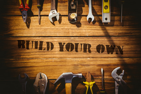 own: The word build your own against desk with tools