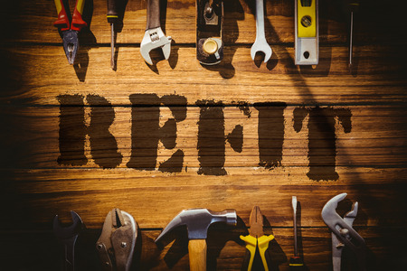 refit: The word refit against desk with tools