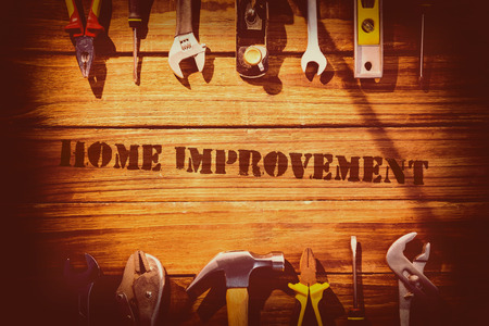 The word home improvement against desk with tools Stock Photo