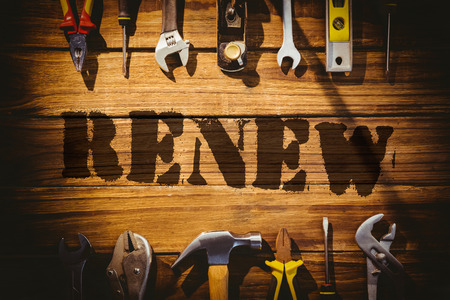 to renew: The word renew against desk with tools