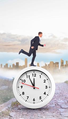 urban sprawl: Businessman running  against rocky path leading to large urban sprawl Stock Photo