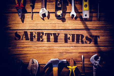safety first: The word safety first against desk with tools