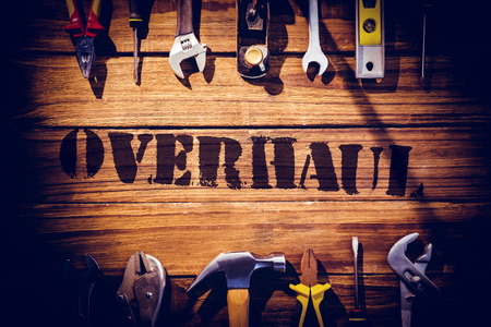 overhaul: The word overhaul against desk with tools Stock Photo