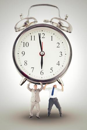 upward struggle: Businessman bending and pushing against white background with vignette Stock Photo