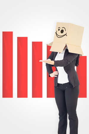 Businesswoman presenting with box over head against wonky smiling face