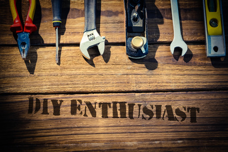 enthusiast: The word diy enthusiast against desk with tools Stock Photo