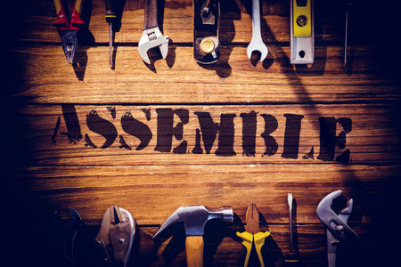 assemble: The word assemble against desk with tools
