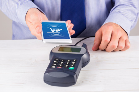 Payment screen against man using smartphone to express pay Stock Photo