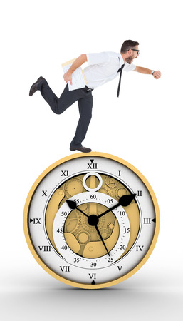running late: Geeky young businessman running late against pretty looking clock