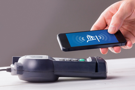 eftpos: Payment screen against man using smartphone to express pay Stock Photo