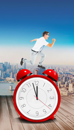 mid air: Geeky happy businessman running mid air against coastal city Stock Photo
