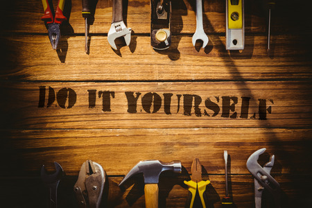 The word do it yourself against desk with tools Imagens - 42549283