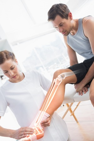 highlighted: Digital composite of Highlighted knee of injured man at physiotherapist Stock Photo