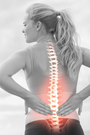 BACK bone: Digital composite of Highlighted spine of woman with back pain Stock Photo