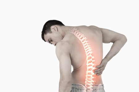 digital composite: Digital composite of Highlighted spine of man with back pain