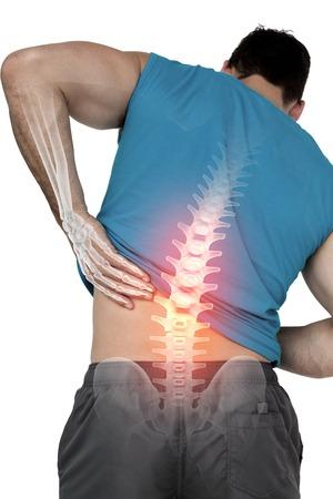 back: Compuesto de Digitaces de Destacado dolor de espalda del hombre en forma Foto de archivo
