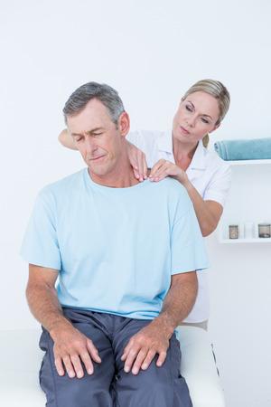 adjustment: Doctor doing neck adjustment in medical office