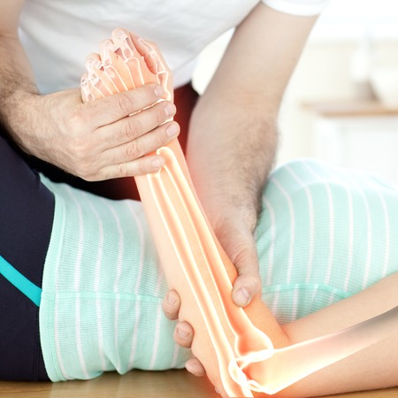 upper limb: Digital composite of Highlighted bones of woman at physiotherapist Stock Photo