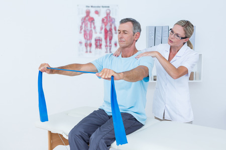 posture correction: Doctor examining her patient back in medical office