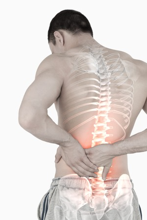 chronic pain: Digital composite of Highlighted spine of man with back pain