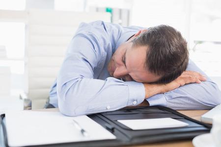 sleeping businessman: Sleeping businessman in his office