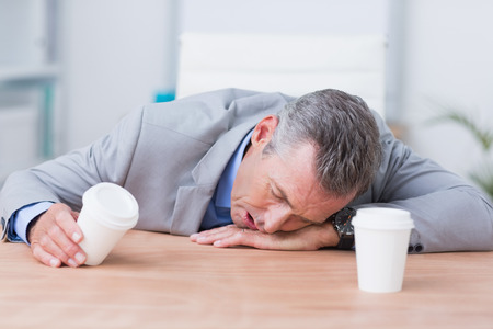 sleeping businessman: Sleeping businessman exhausted in work Stock Photo