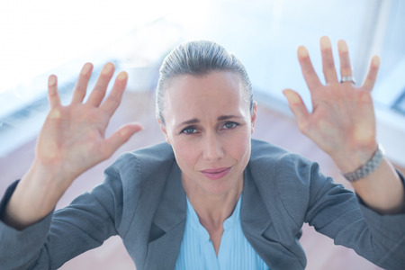 trapped: Businesswoman feeling trapped in an office
