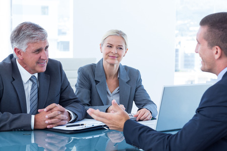 mature business man: Business people conducting an interview in an office Stock Photo