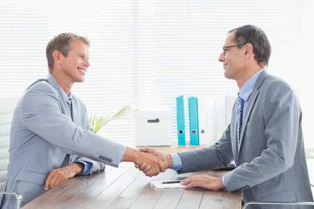 concluding: Concluding a contract between two businessmen in an office