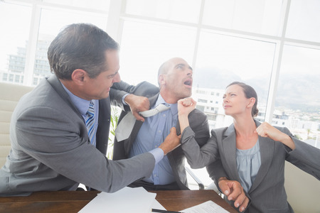 executive woman: Business partners fighting together in an office