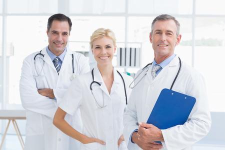 medical doctors: Doctors smiling at camera in medical office