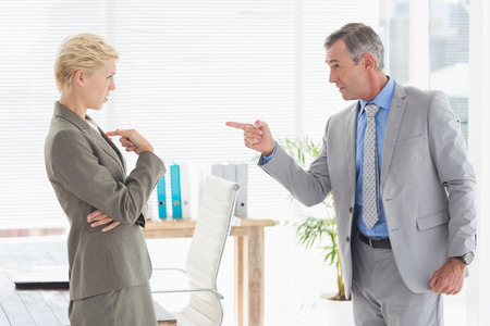 colleague: Boss yelling at colleague Stock Photo