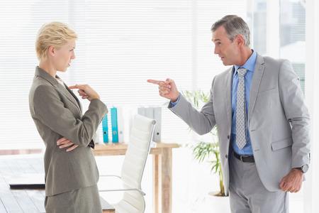 female boss: Boss yelling at colleague Stock Photo