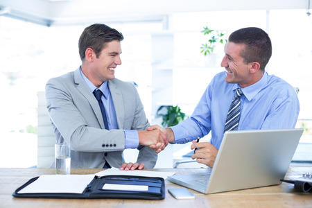 working with hands: Business partners shaking hands in the office