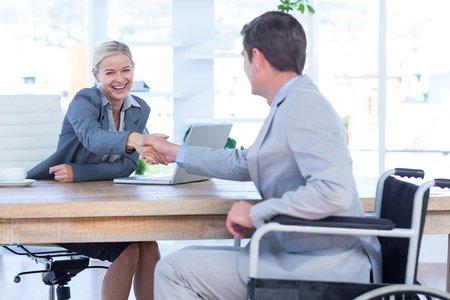 equal opportunity: Businesswoman interviewing disabled job candidate in an office Stock Photo