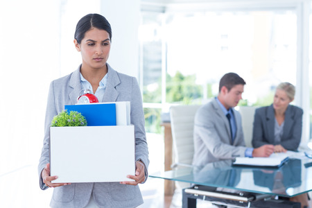 well laid: Businesswoman carrying her belongings in box after being fired