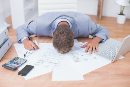 stressed businessman: Businessman being depressed by accounting in his office