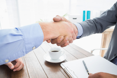 co: Businessman shaking hands with a co worker in an office